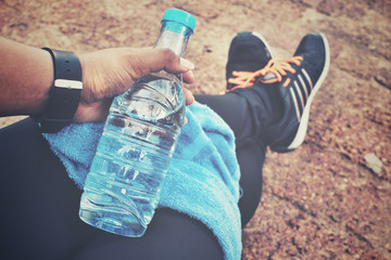 Selfie of sport shoes with water drink and towel