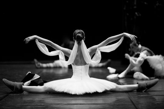 Gorgeous ballerina repeating movements backstage