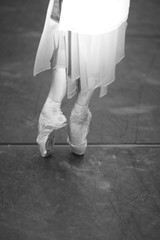 Pointe dancer on stage, closeup of a bellerina's feet