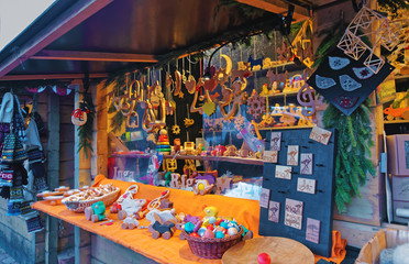 Typical Christmas Market stall with natural wooden souvenirs