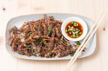 Grasshopper fried in dish.