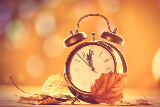Vintage alalrm clock on yellow background