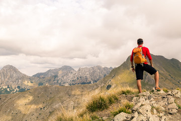 Hiking man or trail runner in mountains