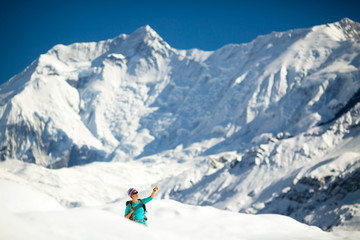 Woman success portrait on mountain peak