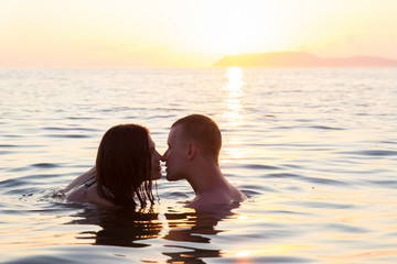 Couple kissing in sea