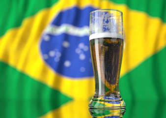a glass of beer in front a brazilian flag
