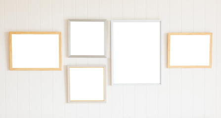Blank photo frame on white wood wall background