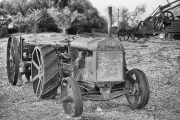 Old rusted antique tractor detail in black and white