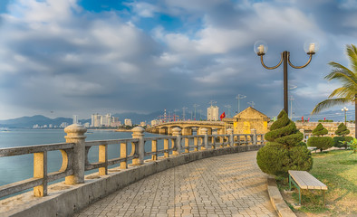 Vietnam, Nha Trang. Panorama of the park and promenade in the rays of the sun.
