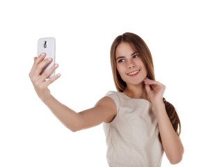 young girl photographing herself with mobile phone