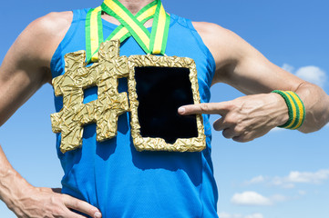 Athlete using tablet hanging next to hashtag gold medal against blue sky
