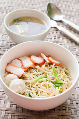 Noodles Soup with Fish Balls on wood table