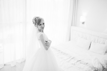 gentle blonde  bride on couch tenderly posed