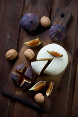 Adygea cheese with figs and walnuts, rustic wooden surface