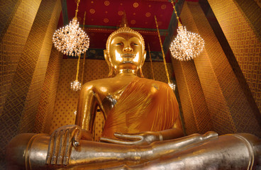 Big golden buddha image inside the hall of Wat Kalayanamitr, Bangkok, Thailand.The temple is created with money donated by people it is public domain and open to the public visits.