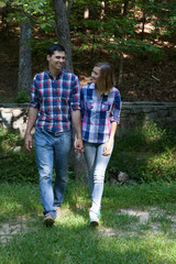 Romantic couple outdoors smiling