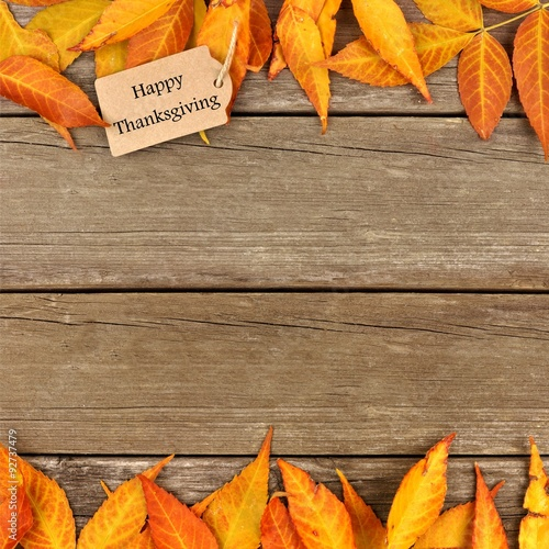Happy Thanksgiving Gift Tag With Double Border Of Colorful Autumn Leaves On A Rustic Wooden Background