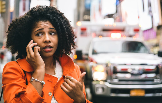 afro american woman calling 911 in New york city. concept about car accidents and emergency