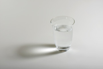 One glass water with white background