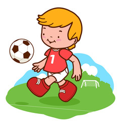 Little boy playing soccer. A happy child plays football