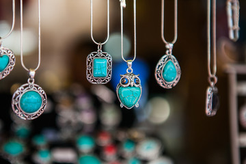 Hand made oval pendants with turquoise stone in a silver frame.