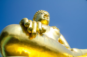 Big Gold Buddha statue in Thailand temple in Asia