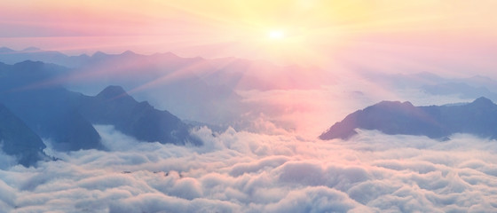 Poster Mountains Dawn above the sea of fog