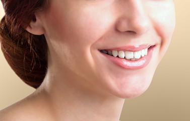Beautiful Woman healthy smile close up. Closeup Ceramic Braces on Teeth. Beautiful Female Smile with Braces.