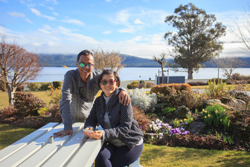 thai people take a photograph with happiness emotion at te anau