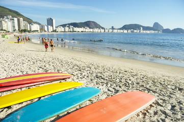 Stand up paddle long board surfboards on Copacabana Beach Rio de Janeiro Brazil