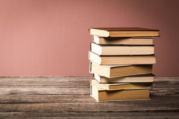 Retro books on pink pastel background