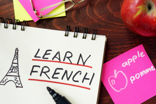 Words learn french written in the notepad.