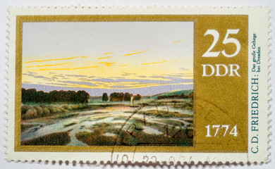 "stamp printed in Germany (GDR) shows stamp  ""The big preserve"" by Caspar David Friedrich, serie 200th birthday of Caspar David Friedrich, circa 1974"