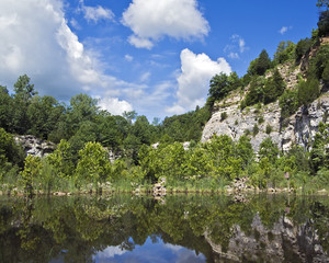 landscape of a wetlands conservation area with limestone bluffs