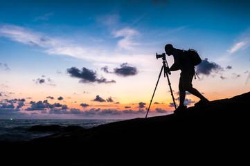 Silhouette photographer on the beach