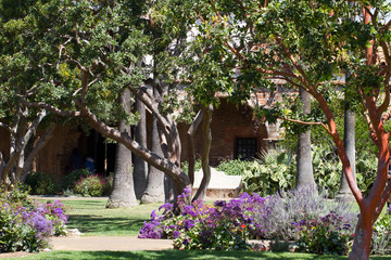 Restored garden inside historic Mission San Juan Capistrano in California