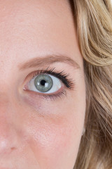 Close-up on beautiful blue eyes of a young woman