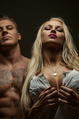 Blond female and shirtless male.