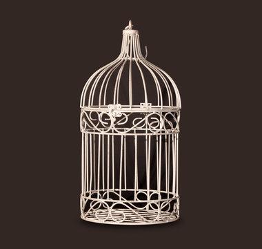 Shabby chic bird cage isolated on black background