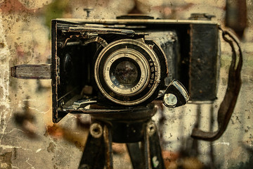Old photo camera. Image digitally manipulated as one old photo. Vintage processed.