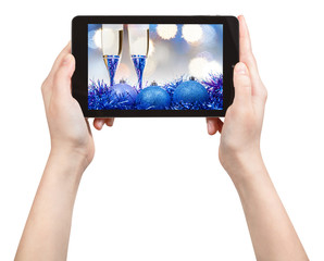 take picture of blue Xmas still life with tablet