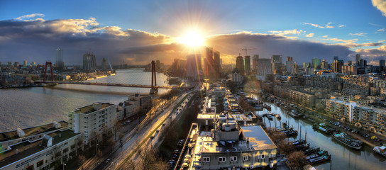 Beautiful sunset panorama of the city of Rotterdam, the Netherlands, with the river Meuse.