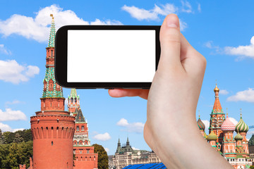 smartphone and Moscow Kremlin Red Towers
