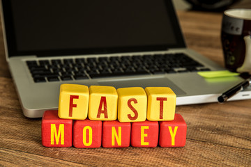 Wooden Blocks with the text: Fast Money
