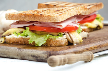 Tasty healthy sandwiches at white wooden table. Rustic style. Shallow focus