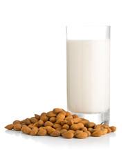 Glass of almond milk with almonds