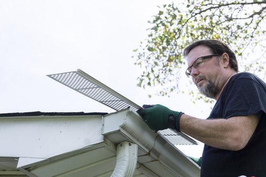 Handyman Installing Gutter Guards