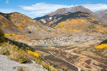 Scenic Silverton, Colorado in the autumn with the orange polluted Animas river running from it