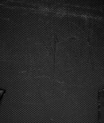 Dark metal grille background