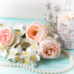 Sweet pastel  roses, jasmine flowers  and candle